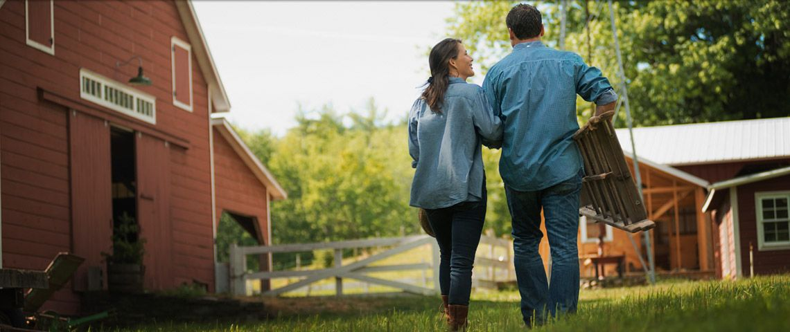 Couple walking near a barn